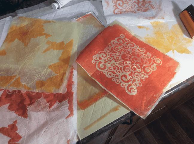 Gelli plate with printed papers - positive and negative prints