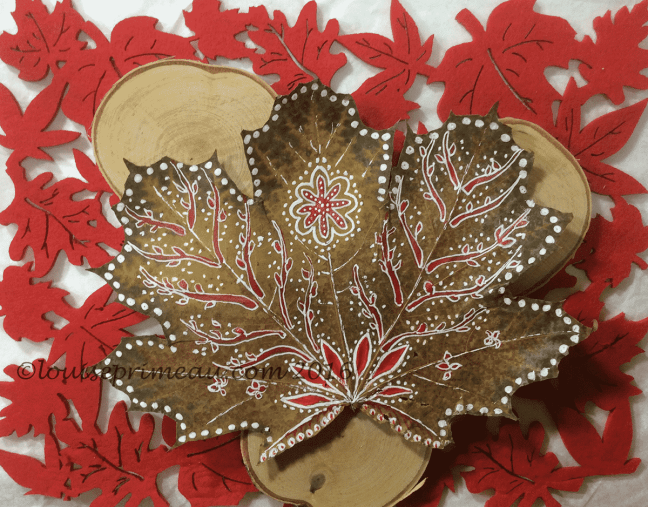 Red and white doodles on maple leaf