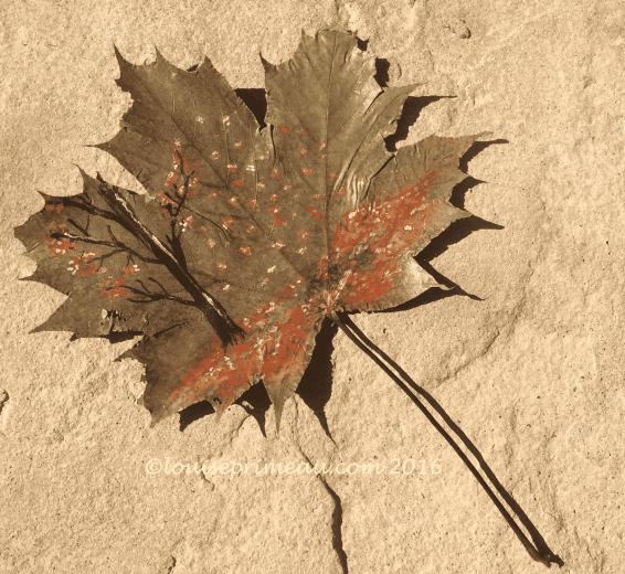fall scene painted on leaf
