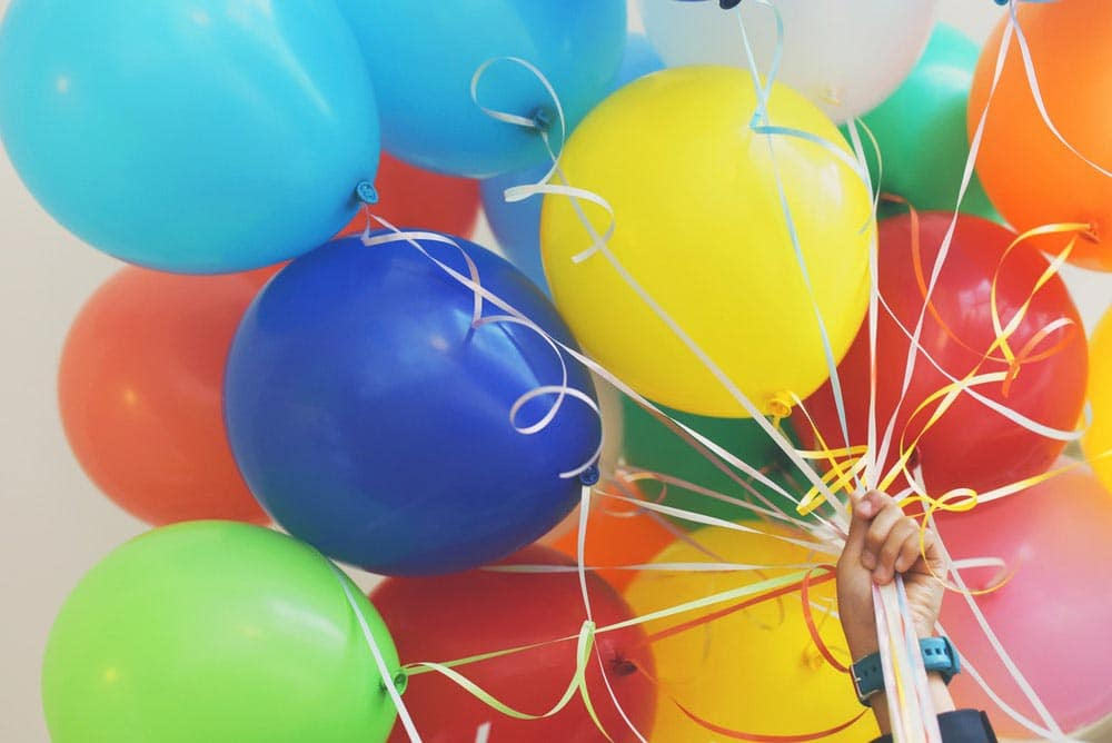 hand holding balloons by Gaelle Marcel