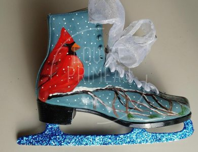 Painted cardinal on repurposed skates by Louise's ARTiculations