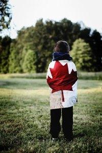 child wearing maple leaf