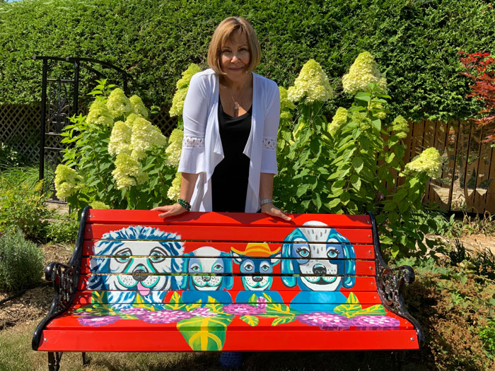 Painted bench in front yard