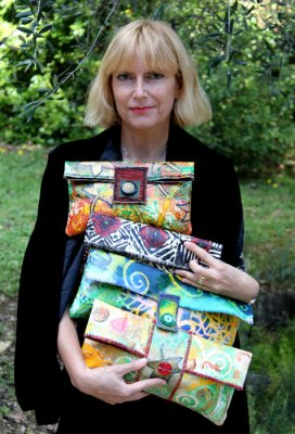Agnes McLaughlin with her painted art bags.