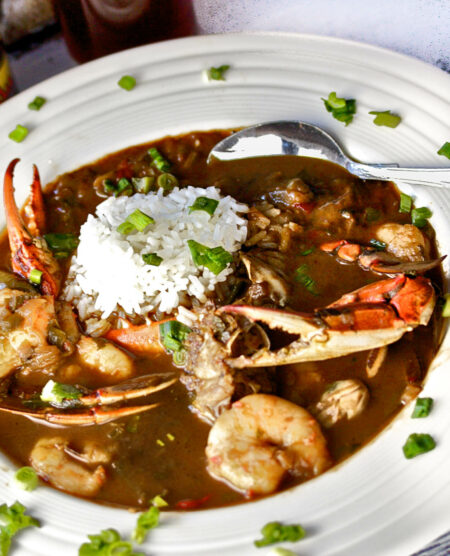closer up photo bowl of dark roux of seafood gumbo