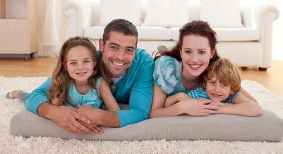 Family on carpet flooring