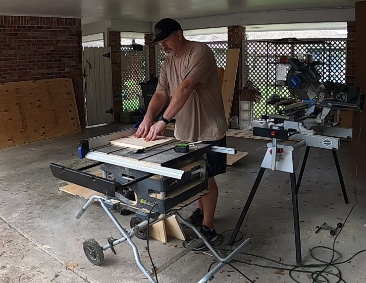 Cutting the wood to build the Halloween DIY Coffin