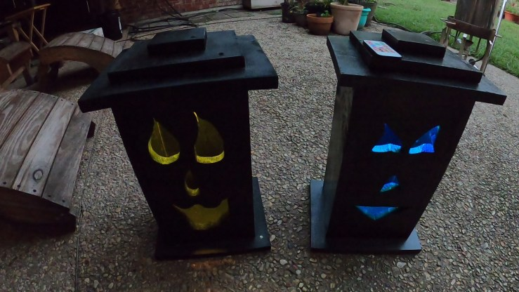 Completed Jack-O-Lantern Light-up Boxes with lights on.