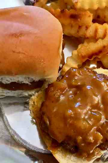 A tasty barbecue sauce made with onion, mustard, and honey on a grilled burger.