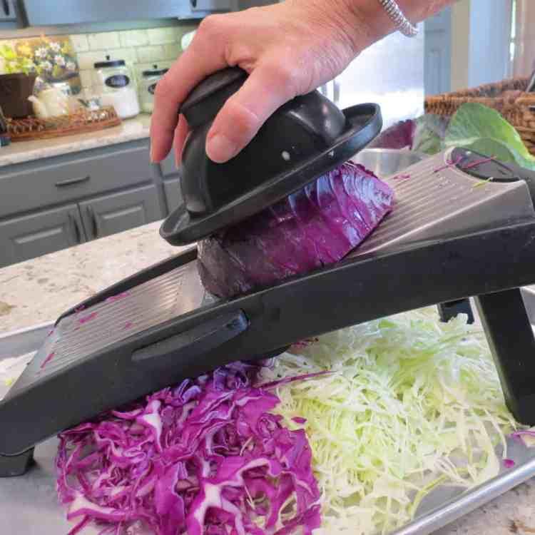 Slicing cabbage with mandolin.