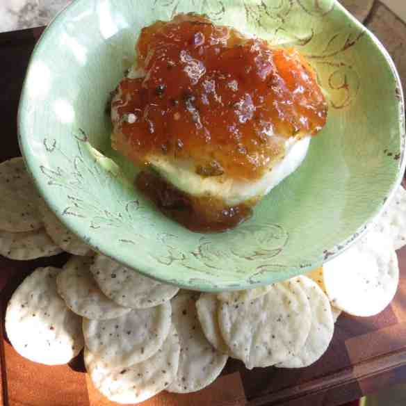 Fig Pepper Jelly on a block of cream cheese.