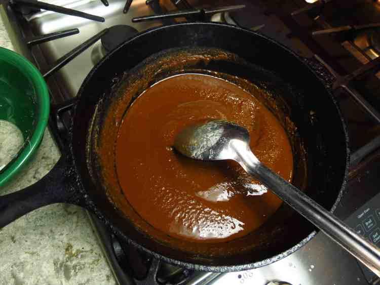 Black pot of dark roux.