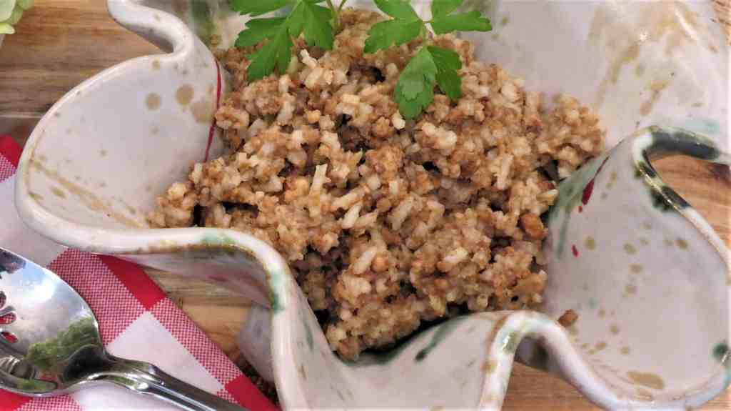Rice dressing in a gray pottery bowl.