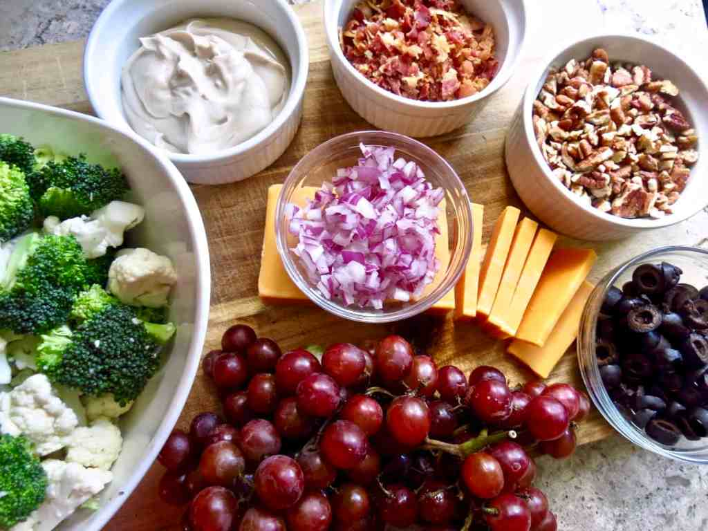 salad ingredients on wooden cutting board