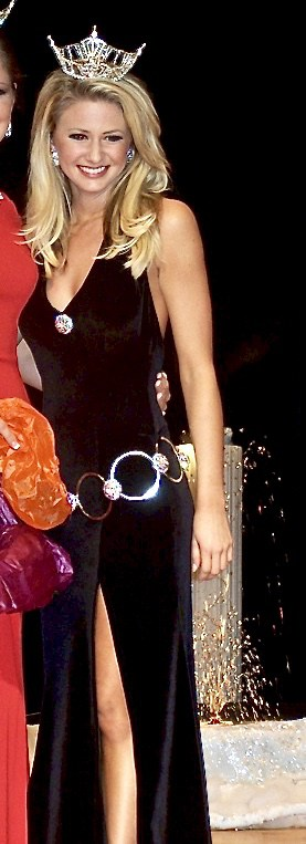 Girl wearing black evening gown.