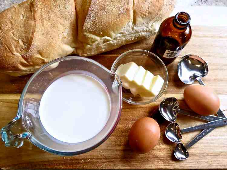 Ingredients for French toast on wooden board.
