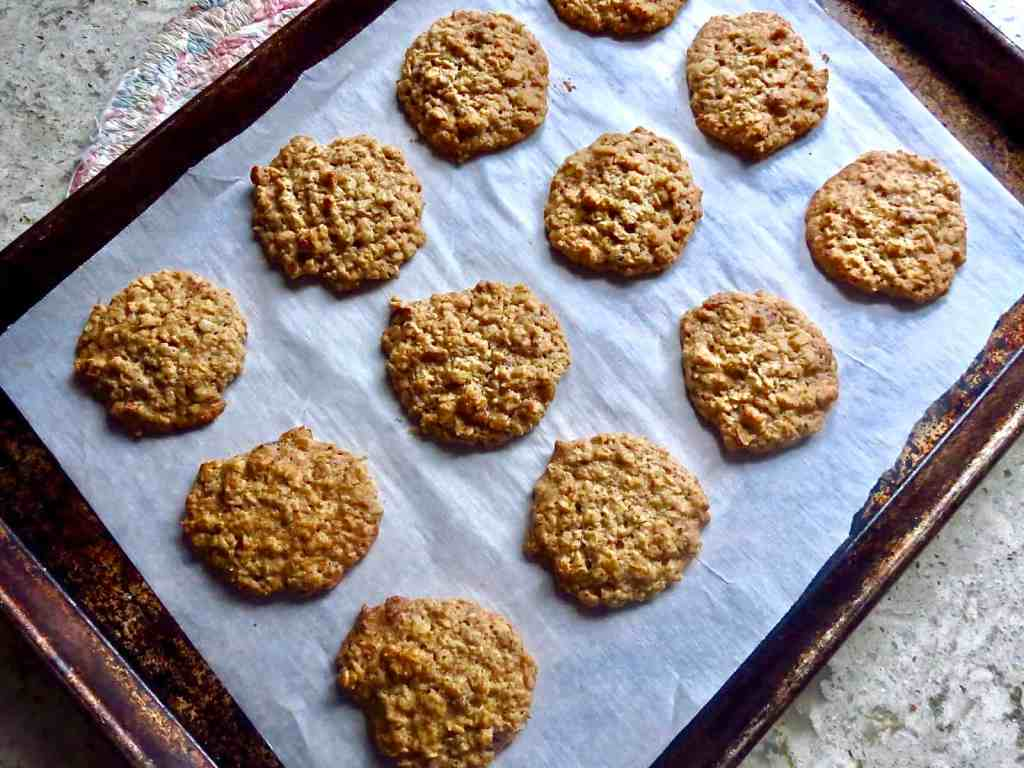 Lunchroom Lady Oatmeal Cookies baked on a cookie sheet lined with parchment paper.