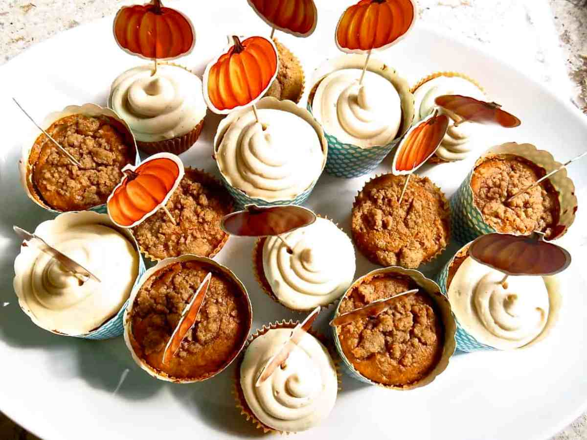 A white tray of different Pumpkin Muffins With Streusel.
