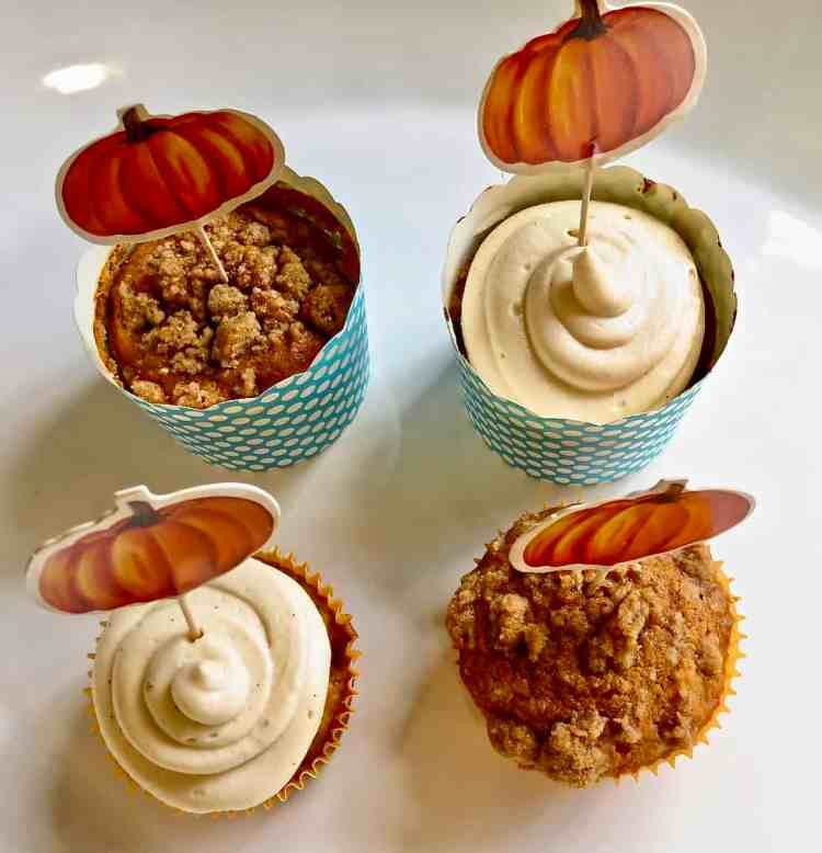 Two pumpkin cupcakes and two Pumpkin Muffins With Streusel on a white tray.