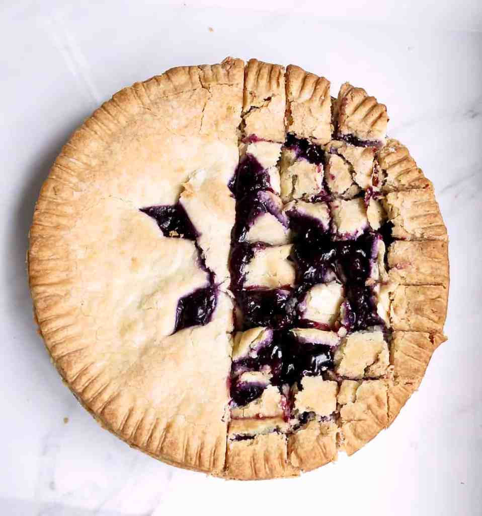 A blueberry pie on a white tray for Easy Pie Trifle Dessert.