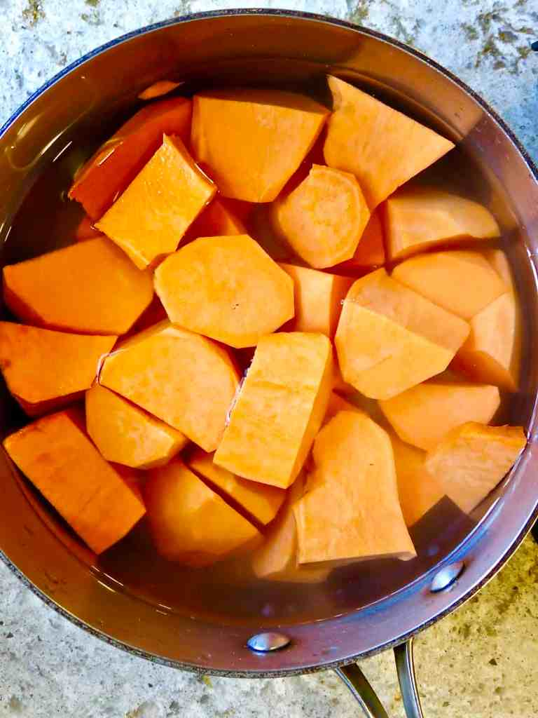 Cubed sweet potatoes in a pot of water to boil for Fresh Sweet Potato Casserole.