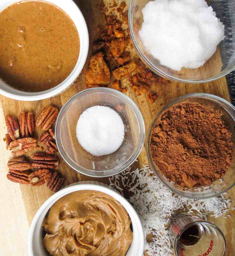 Ingredients for Fat Bombs on a wooden board.