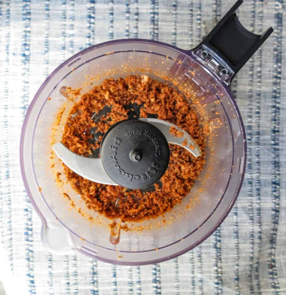 A small food processor with ground Cajun cracklins in it for Fat Bombs.