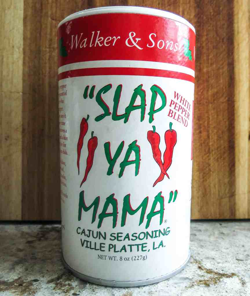 A container of Slap Ya Mama Cajun Seasoning white pepper blend for Shrimp And Corn Soup.