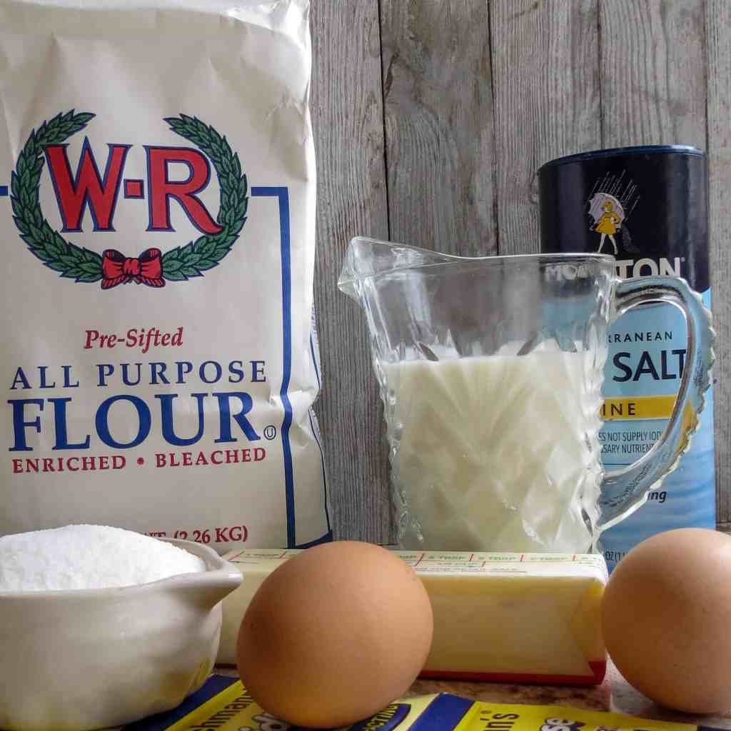 Ingredients of yeast, flour, milk, salt, sugar and butter for Easy No-Knead Bread .