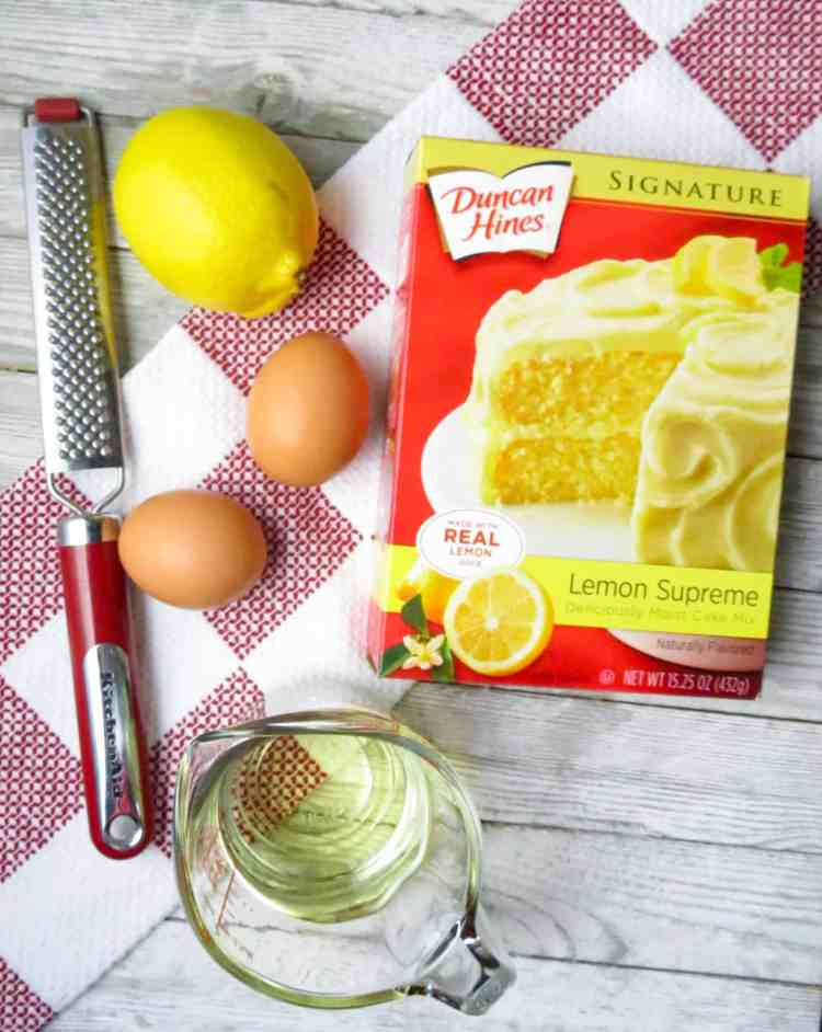 Ingredients to Lemon Cake Mix Cookies on a red and white towel.