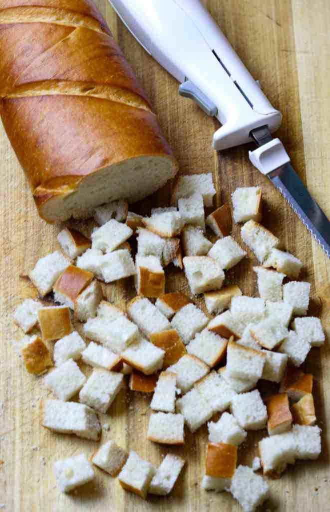 A loaf of bread sliced into cubes.