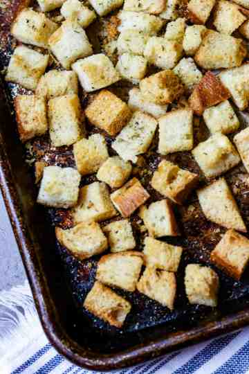 A sheet pan of baked croutons.