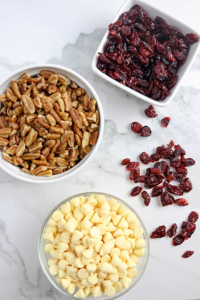 Bowls of ingredients for Cranberry White Chocolate Cookies.