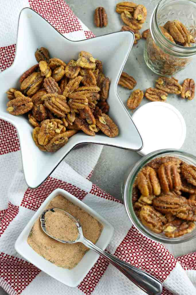 Roasted pecans in a star-shaped bowl and a jar.