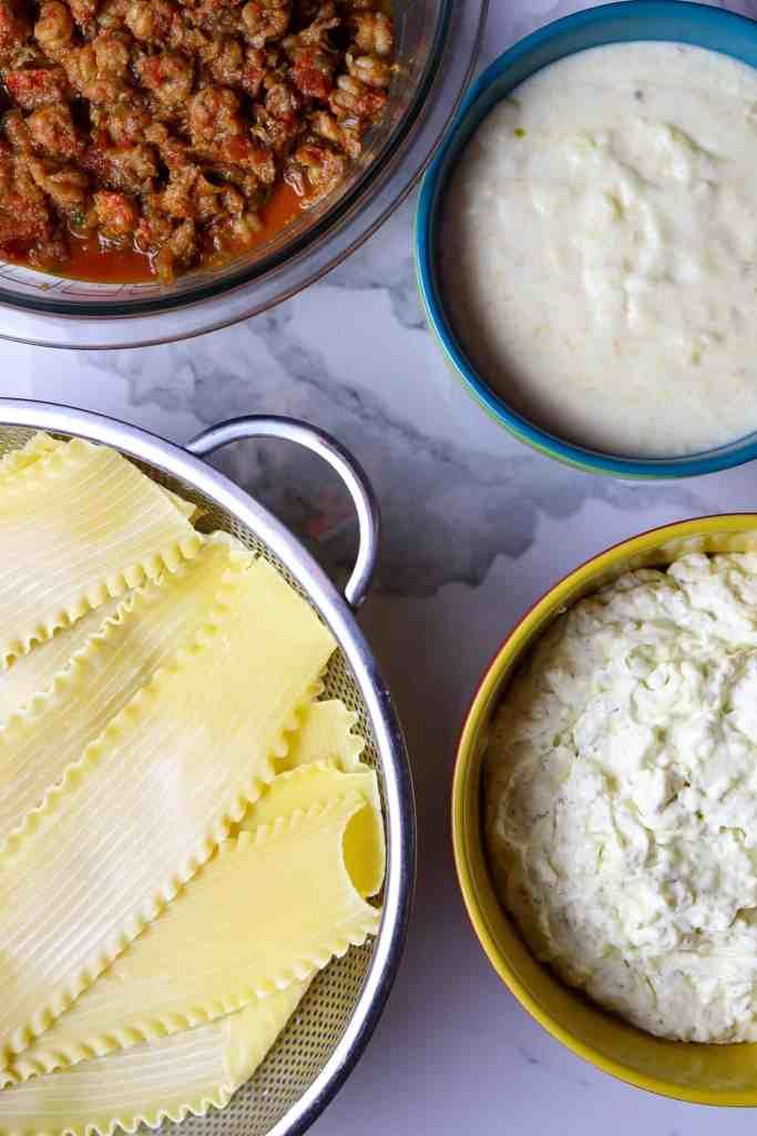 Bowls of ingredients for Crawfish Lasagna.