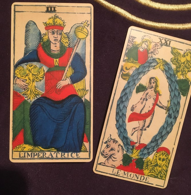 Image of the empress and world card from Marseilles tarot