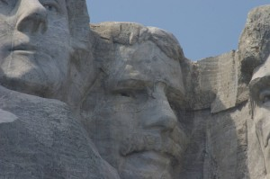 Mt. Rushmore w/President Roosevelt center, partial of Presidents Jefferson and Lincoln (left and right)