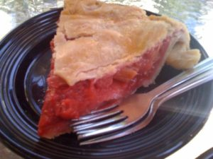 A piece of strawberry rhubarb pie