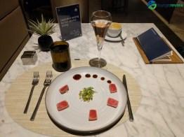 United Polaris Lounge Chicago O'Hare restaurant service: Seared tuna tataki
