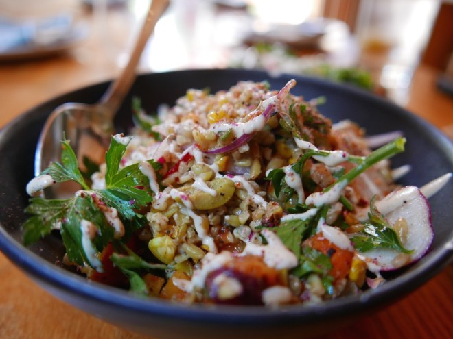 Charred corn, tabbouleh, orange, freekeh, almond, radish, olive, tahini