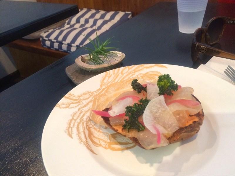 Swordfish Pancetta, carmelized tomato, kale tartine open-faced sandwich