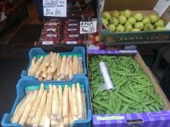 Vegetables set up on the sidewalk