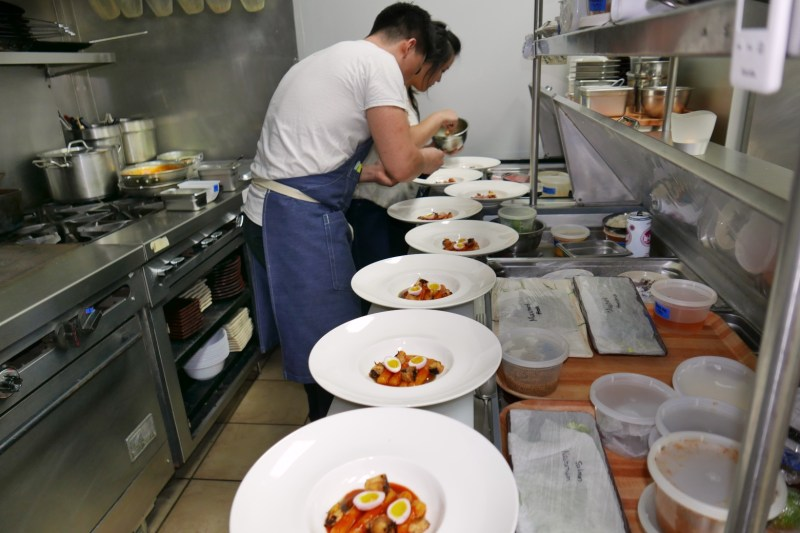 Prepping the tteokbokki dish at Hanbun
