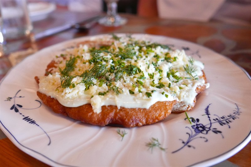 Hungarian Langos, fried potato bread, chive sour cream, gouda
