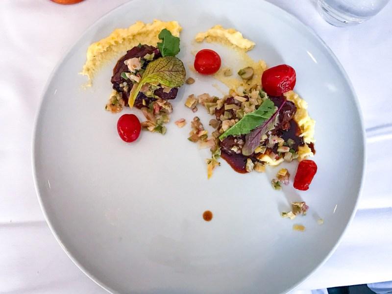 Veal, polenta, eggplant, tomato, herbs, cheddar