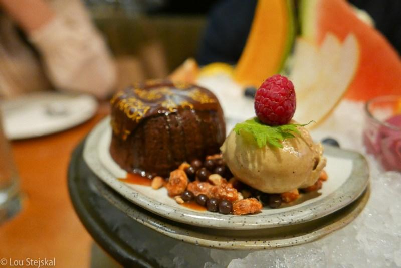 Warm Chocolate Cake with Coffee Ice Cream, Caramel Sauce, Caramelized Peanuts