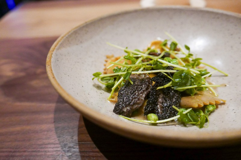 From the Menu: Fermented Black Bean Agnolotti, morels, sugar peas ($19)
