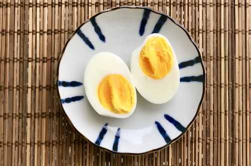 Boiled egg used in diet cut in half on a plate
