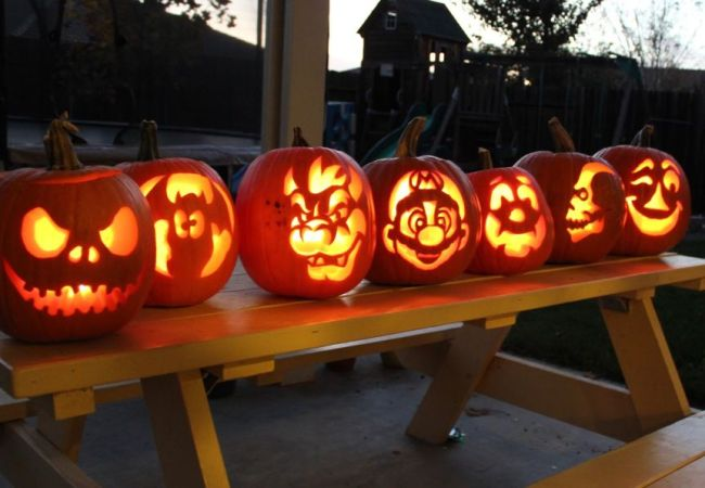 Carved pumpkins sitting on table