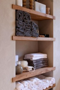 Inspiring Bathroom Decoration Ideas With Wooden Storage 32